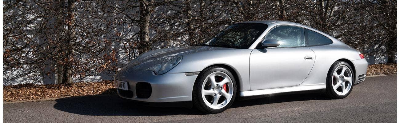 2004 Artic Silver Porsche 996 Carrera 4S at Goodwood Motor Circuit