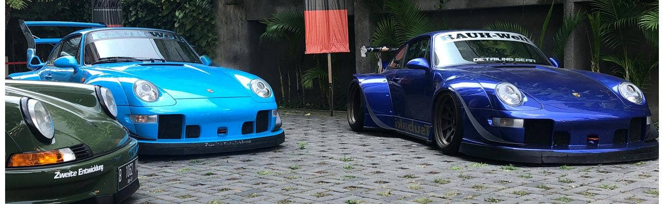 RWB Porsche and VW Barndoor Bus