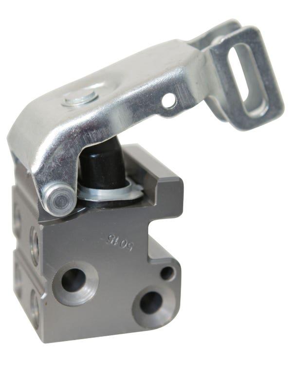 Regulador de presión de frenos para tambores de frenos traseros