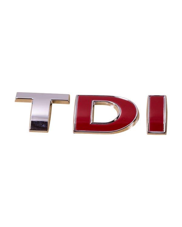 Insignia trasera de TDI en rojo y cromo
