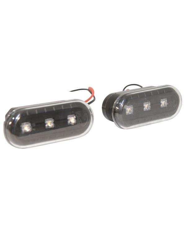Pareja de intermitentes laterales con lente transparente y negra de LED